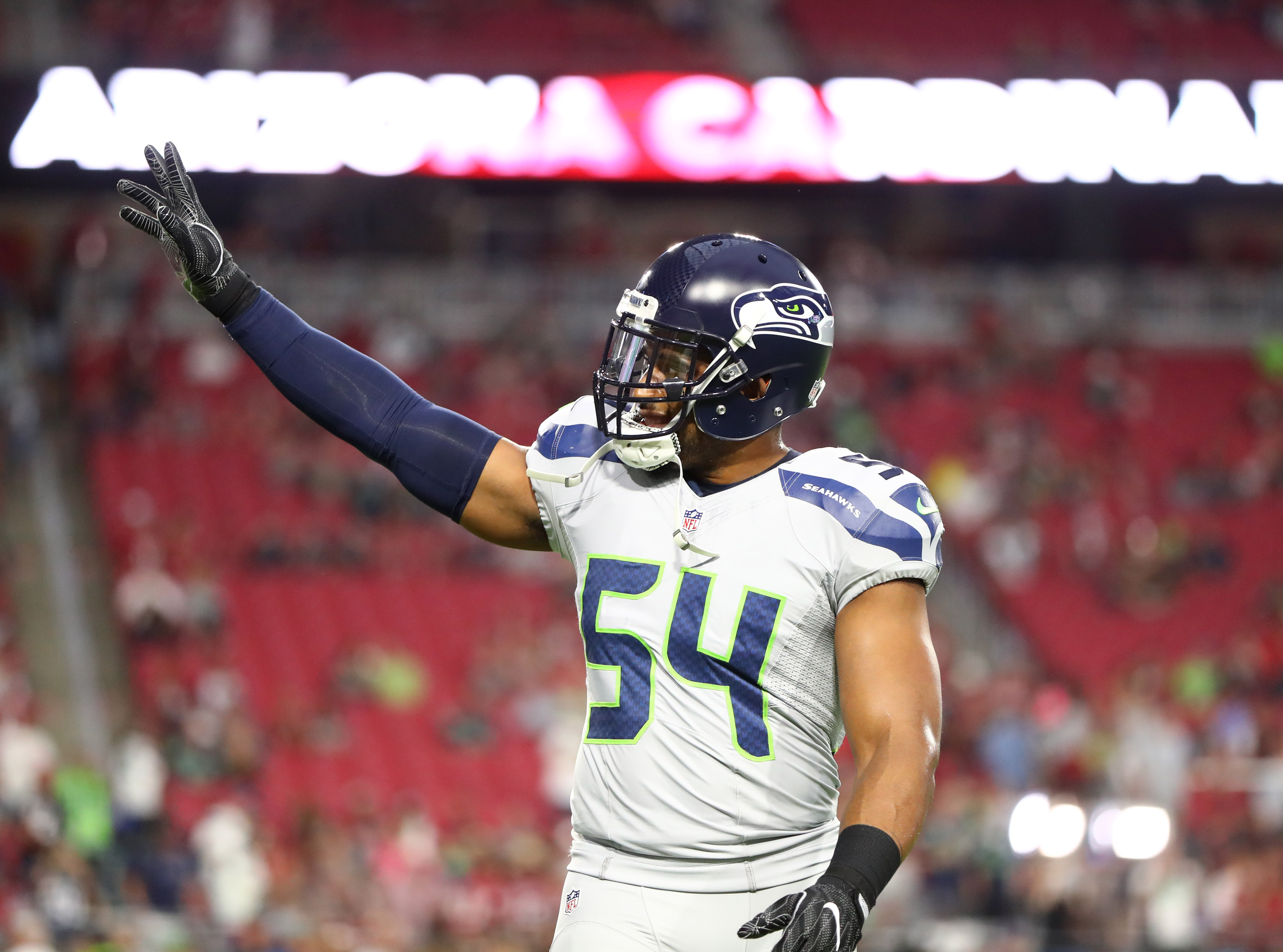 7a48420d2 ... Seahawks linebacker Bobby Wagner (54) reacts against the Arizona  Cardinals at University of Phoenix Stadium. The game ended in a 6-6 tie  after overtime.